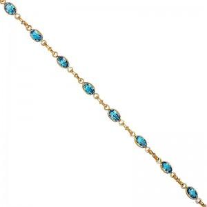 - Bracelet or 750/1000, maille jaseron et  topaze bleue -